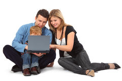 Father, mother and child look on laptop Stock Photography