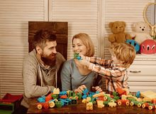 Father and mother with child play constructor. happy family and childrens day. Little boy with dad and mom. little boy stock image