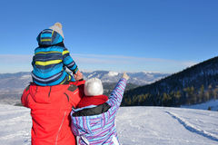 Father, mother and children are having fun and playing on snowy winter walk in nature. Stock Image