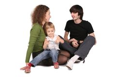 Father and mother and daughter with cell phone Royalty Free Stock Image