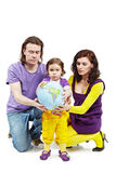 Father, mother and daughter hold ball-earth. Father, mother and little daughter hold inflatable ball-earth Stock Photo
