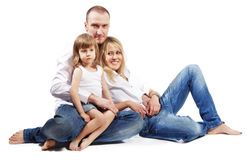Father, mother and daughter sit on floor Stock Photos