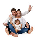 Father, mother, daughter, sitting in the studio Stock Photos