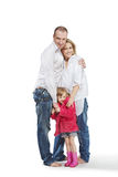 Father, mother and daughter stand embraced Royalty Free Stock Photo
