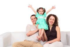 Father, mother and daughter on white leather sofa Stock Photos