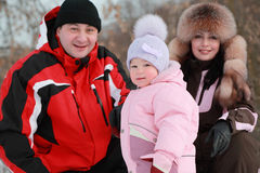 Father, mother and daughter at winter on nature Stock Photography