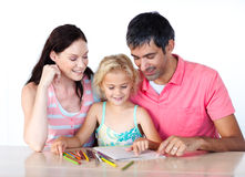 Father and mother drawing with her daughter Stock Images
