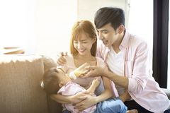 father and mother feeding baby from bottle royalty free stock photo