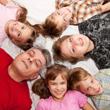 Father, mother and four children smiling. Stock Images