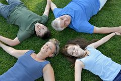Family, father, mother, son and daughter lying in the meadow stock images