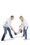 Father and mother hold daughter for hands and feet Stock Photography