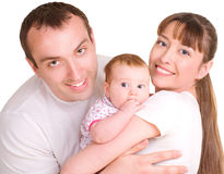 Father and mother are holding their baby Royalty Free Stock Photos