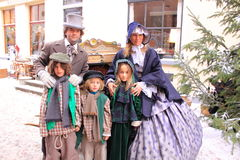 Father, mother and kids in the Middle Ages. Old fashioned family depicting one from the Middle Ages during the Charles Dickens festival in the city centre of stock photos