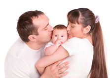 Father and mother kissing her baby Royalty Free Stock Photography
