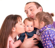 Father and mother kissing her baby. Over white background Royalty Free Stock Photography