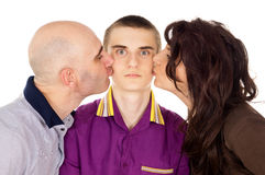 Father and mother kissing her son. Father and mother kissing son cheek Royalty Free Stock Images