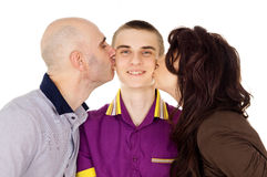 Father and mother kissing son cheek Royalty Free Stock Images