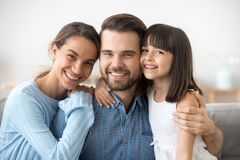 Father mother and little daughter looking at camera royalty free stock photo