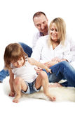 Father, mother and little daughter sit on carpet Royalty Free Stock Photo