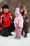 Father, mother and little daughter at snow Stock Photo