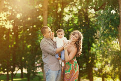 Father, mother and little son playing outside in summer Royalty Free Stock Image