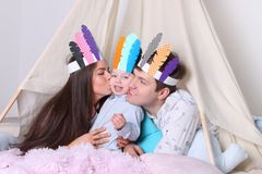 Father, mother, little son pose in wigwam Stock Image