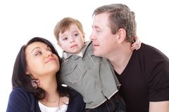 Father and mother look at boy Stock Photography