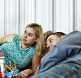Father and mother play with their little son on the couch at home. Close up royalty free stock photography