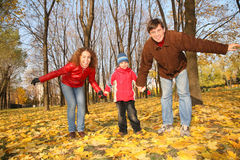 Father and mother with the son in autumn Royalty Free Stock Photo