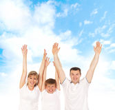 Father, mother and son on a blue sky background Stock Images
