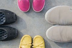 Father mother son and daughter shoes on floor, family protect concept. Father mother son and daughter shoes on floor, family concept Stock Images