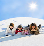 Father, Mother, son and daughter on snow Stock Photo