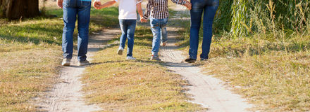 Father, mother, son and daughter walking Stock Photography