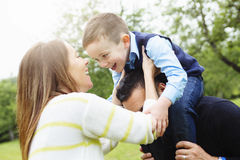 Father mother and son in forest having fun Royalty Free Stock Photos