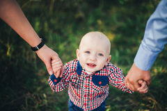 Father mother and son holding hand. Father mother and baby son holding hand in hand Royalty Free Stock Photography