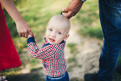 Father mother and son holding hand. Father mother and baby son holding hand in hand Stock Image