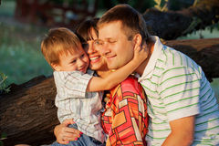 Father, mother and son hugging Stock Image