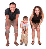 Father, mother and son look having bent down Stock Photos