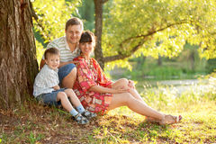 Father, mother and son in the park. Summer holiday. Happy family outdoors royalty free stock photos