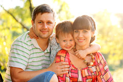 Father, mother and son in the park. Stock Photos