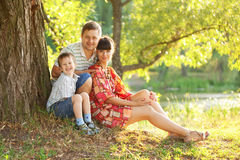 Father, mother and son in the park. Royalty Free Stock Photo