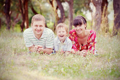 Father, mother and son in the park. Summer holiday. Stock Photo