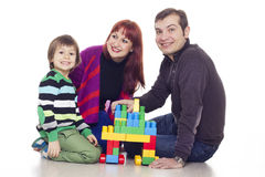 Father, mother and son playing lego Stock Photo