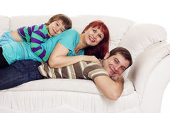 Father, mother and son resting on the sofa Stock Image