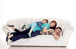 Father, mother and son resting on the sofa Stock Photo