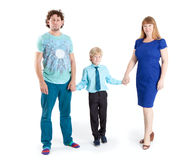 Father and mother with son a schooler looking at camera, isolated white background Royalty Free Stock Photo