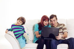 Father, mother and son sitting on the sofa with notebook Royalty Free Stock Photography
