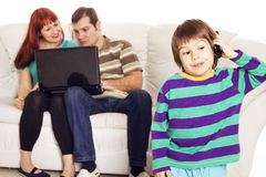 Father, mother and son sitting on the sofa with notebook Stock Photos