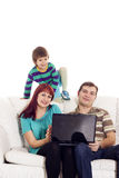 Father, mother and son sitting on the sofa with notebook Stock Image
