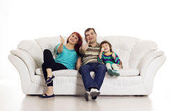Father, mother and son sitting on the sofa showing hand ok sign Stock Photography